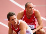 Richard Yates of England and Dai Greene of Wales look on after the Men's 400 metres hurdles heats at Hampden Park during day seven of the Glasgow 2014 Commonwealth Games on July 30, 2014