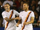 Francesco Totti #10 of AS Roma celebrates a goal with Radja Nainggolan #4 against Real Madrid during a Guinness International Champions Cup 2014 game at Cotton Bowl on July 29, 2014