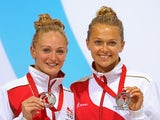 Sarah Barrow and Tonia Couch of England pose with their silver medals after finishing second in the women's synchronised 10m platform event at the Commonwealth Games on July 30, 2014