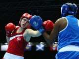 Savannah Marshall of England competes againsts Pearl Moraka of Botswana Women's Middle 69-75kg Division Boxing quarterfinals at Scottish Exhibition And Conference Centre during day seven of the Glasgow 2014 Commonwealth Games on July 30, 2014