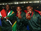 South African players Seabelo Senatla, Cecil Africa and Branco du Preez celebrate after win after the final match between South Africa and New Zealand at Ibrox Stadium during day four of the Glasgow 2014 Commonwealth Games on July 27, 2014