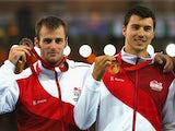 Silver medallist Luke Cutts of England and gold medallist Steven Lewis of England pose on the podium during the medal ceremony for the Men's Pole Vault at Hampden Park during day nine of the Glasgow 2014 Commonwealth Games on August 1, 2014