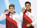 England's Tom Daley and James Denney pose on the podium after winning the silver medal in the Men's Synchronised 10m Platform Diving Competition at the Royal Commonwealth Pool during the 2014 Commonwealth Games in Edinburgh, Scotland, on August 1, 2014