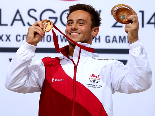 Tom Daley of England celebrates on the podium after winning the Gold medal in the Men's 10m Platform Final at the Royal Commonwealth Pool during day ten of the Glasgow 2014 Commonwealth Games on August 2, 2014