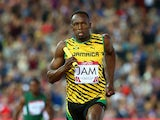 Usain Bolt competes in the Men's 4x100 metres relay heats at Hampden Park during day nine of the Glasgow 2014 Commonwealth Games on August 1, 2014