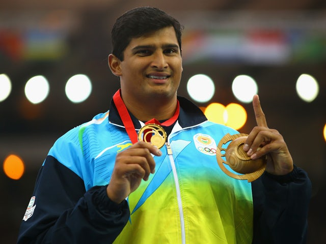 Gold medallist Vikas Shive Gowda of India poses on the podium during the medal ceremony for the Men's Discus Throw at Hampden Park during day eight of the Glasgow 2014 Commonwealth Games on July 31, 2014