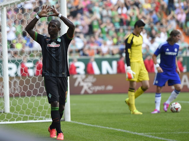 Werder Bremen's Dutch midfielder Eljero Elia reacts after scoring against Chelsea FC in a friendly football match on August 3, 2014