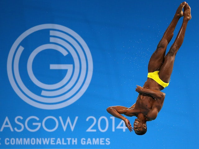Jamaica's Yona Knight-Wisdom competes in the Commonwealth Games men's 3m springboard preliminaries at the Royal Commonwealth Pool in Edinburgh on July 31, 2014