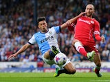Jason Lowe of Blackburn Rovers in action with Matt Connolly of Cardiff City during the Sky Bet Championship match between Blackburn Rovers and Cardiff City at Ewood Park on August 08, 2014