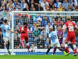 Kenwyne Jones of Cardiff City scores the opening goal during the Sky Bet Championship match between Blackburn Rovers and Cardiff City at Ewood Park on August 08, 2014