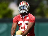 Carlos Hyde #28 of the San Francisco 49ers stretches during 49ers Rookie Minicamp on May 23, 2014