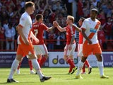 Chris Burke celebrates scoring Nottingham Forest's second against Blackpool on August 9, 2014
