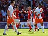 Chris Burke celebrates scoring Nottingham Forest's second against Blackpool on August 9, 2014