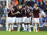 Danny Wilson is congratulated by Hearts teammates after he scores the opener against Rangers on August 10, 2014