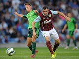 Dean Marney of Burnley in action with Yelko Pino of Celta Vigo during the pre season friendly match between Burnley and Celta Vigo at Turf Moor on August 05, 2014