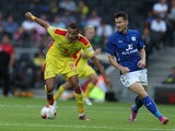 Dele Alli of MK Dons looks to control the ball watched by David Nugent of Leicester City during the Pre-Season Friendly match on August 4, 2014