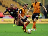 Norwich's Elliott Bennett is challenged by Richard Stearman of Wolves on August 10, 2014