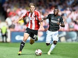 James Tarkowski of Brentford and Igor Vetokele of Charlton Athletic on August 9, 2014