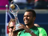 Jo-Wilfried Tsonga celebrates winning the Rogers Cup on August 10, 2014