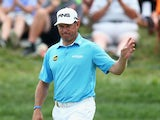 Lee Westwood of England waves during the first round of the 96th PGA Championship at Valhalla Golf Club on August 7, 2014