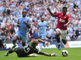Manchester United's Portuguese midfielder Nani goes round Manchester City's English goalkeeper Joe Hart to score the third and winning goal during the FA Community Shield football match at Wembley Stadium in London, England on August 7, 2011