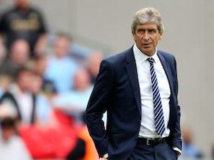 "Pellegrini: Man City were ""very solid"""