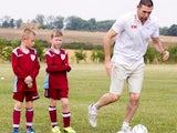 Martin Keown demonstrates how not to dribble in front of some unimpressed youngsters