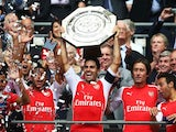 Mikel Arteta holds the Community Shield as Arsenal celebrate on August 10, 2014