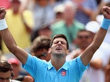 Novak Djokovic of Serbia celebrates after winning against Gael Monfils of France during Rogers Cup at Rexall Centre at York University on August 6, 2014