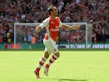 Santi Cazorla celebrates scoring Arsenal's opener against Man City in the Community Shield on August 10, 2014