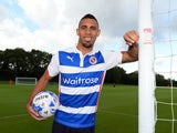 Anton Ferdinand poses in a Reading shirt after signing for the Royals on August 11, 2014