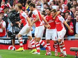 Aaron Ramsey of Arsenal celebrates his goal with team mate Mikel Arteta during the Barclays Premier League match between Arsenal and Crystal Palace at Emirates Stadium on August 16, 2014