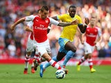 Mathieu Debuchy of Arsenal and Yannick Bolasie of Crystal Palace battle for the ball during the Barclays Premier League match between Arsenal and Crystal Palace at Emirates Stadium on August 16, 2014