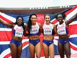 Asha Philip, Ashleigh Nelson, Anyika Onuora and Desiree Henry pose with a Union Jack after winning gold in the Women's 4x100 metres relay final during day six of the 22nd European Athletics Championships at Stadium Letzigrund on August 17, 2014
