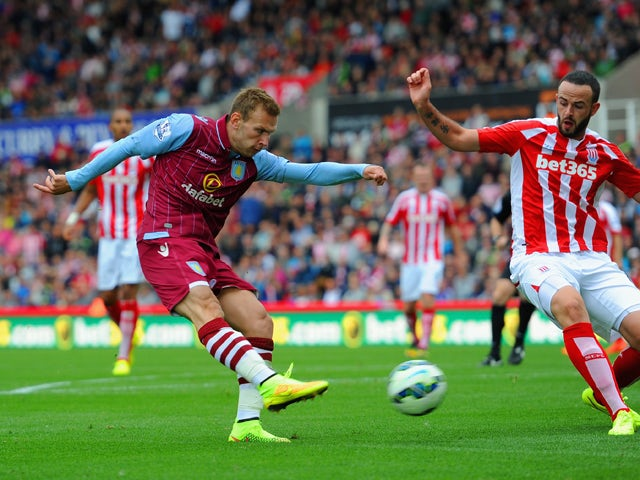 Andreas Weimann of Aston Villa scores the opening goal during the Barclays Premier League match between Stoke City and Aston Villa at Britannia Stadium on August 16, 2014
