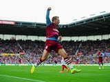 Andreas Weimann of Aston Villa celebrates scoring the opening goal during the Barclays Premier League match between Stoke City and Aston Villa at Britannia Stadium on August 16, 2014