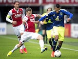 Ajax Amsterdam's Dutch forward Ricardo Kishna vies for the ball with AZ Alkmaar's Swedish defender Mattias Johansson during the Dutch Eredivisie football match between Ajax Amsterdam and AZ Alkmaar in Alkmaar, Netherlands, on August 17, 2014