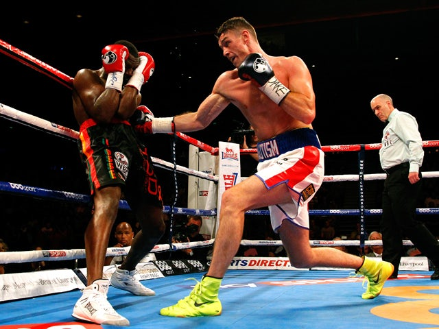 Callum Smith of England in action with Vladine Biosse of the USA during their WBC International Super Middleweight Championship fight at the Liverpool Echo Arena on July 12, 2014