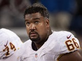 Chris Chester #66 of the Washington Redskins looks on during the game against the Minnesota Vikings on November 7, 2013
