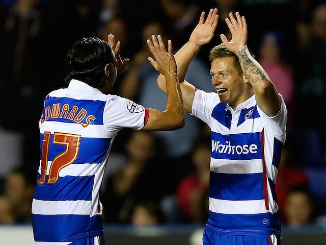 Craig Tanner of Reading is congratulated by team mate Ryan Edwards after scoring his team's third goal of the game during the Capital One Cup First Round match against Newport on August 12, 2014