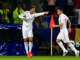 Cristiano Ronaldo of Real Madrid celebrates with teammate James Rodriguez after scoring their team's second goal during the UEFA Super Cup against Sevilla on August 12, 2014