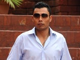 Pakistani discarded cricket leg-spinner Danish Kaneria leaves after appeared the integrity committee at the Gaddafi stadium in Lahore on August 15, 2011