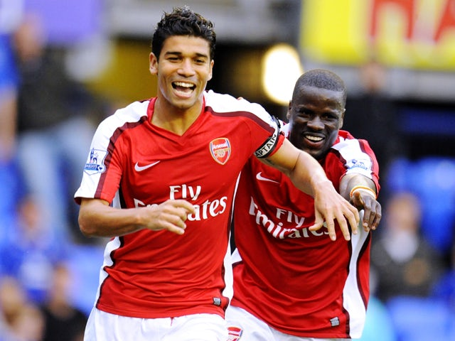 Eduardo Da Silva of Arsenal celebrates with teammate Emmanuel Eboue after scoring his team's sixth goal during the Barclays Premier League match between Everton and Arsenal at Goodison Park on August 15, 2009