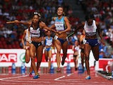 Floria Guei of France, Olha Zemlyak of Ukraine and Margaret Adeoye of Great Britain and Northern Ireland cross the finish line during the Women's 4 x 400m Relay Final during day six of the 22nd European Athletics Championships at Stadium Letzigrund on Aug