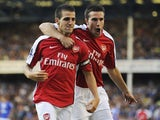 Francesc Fabregas of Arsenal is congratulated by teammate Robin van Persie (R) after scoring his team's fourth goal during the Barclays Premier League match between Everton and Arsenal at Goodison Park on August 15, 2009