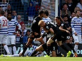 James Chester #5 of Hull City is congratulated by teammates after scoring the opening goal during the Barclays Premier League match between Queens Park Rangers and Hull City at Loftus Road on August 16, 2014