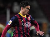 Barcelona's Dutch forward Ibrahim Afellay drives the ball during the Spanish league football match FC Barcelona vs Malaga CF at the Camp Nou stadium in Barcelona on January 26, 2014
