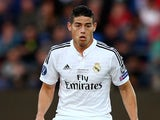 James Rodriguez of Real Madrid controls the ball during the UEFA Super Cup between Real Madrid and Sevilla FC at Cardiff City Stadium on August 12, 2014