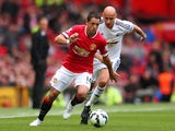 United's Javier Hernandez is chased by Jonjo Shelvey of Swansea on August 16, 2014