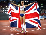 Jo Pavey of Great Britain and Northern Ireland poses with a Union Jack after winning gold in the Women's 10,000 metres final on August 12, 2014